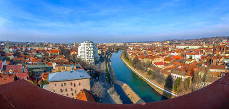 Aerial view from the city hall tower over Oradea town with new and historic buildings. Crisul Repede, the local river, in front.