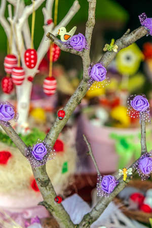 Small multicolored arrangement to decorate the house for Easter, made from children.