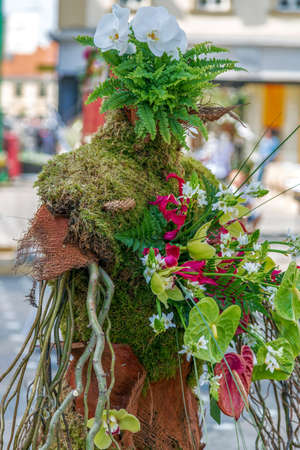 Beautiful street floral decorations that symbolize one human form in Victory Square of Timisoara, Romania.