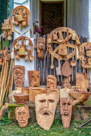 TIMISOARA, ROMANIA - SEPTEMBER 27, 2014; Objects decorative wooden carved, traditional Romanian, and exposed for sale.