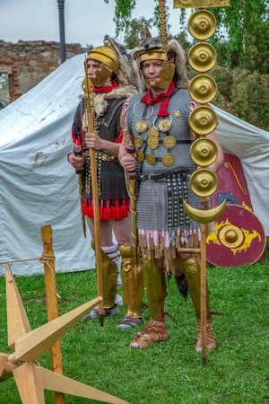 ALBA IULIA, ROMANIA - APRIL 29, 2017: Camp of Roman soldiers in battle costume, present at APULUM ROMAN FESTIVAL, organized by the City Hall. Редакционное
