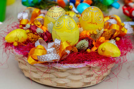 Small multi colored arrangement to decorate the house for Easter, made from children.