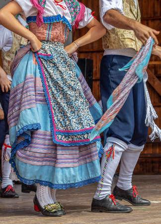 Detail of traditional folk costumes of Italian dancers that perform  dance. Фото со стока