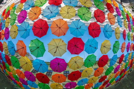 Background with colored umbrellas on one street in Timisoara, Romania.