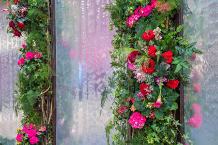 Floral decorations on a background of glass with flowing water.