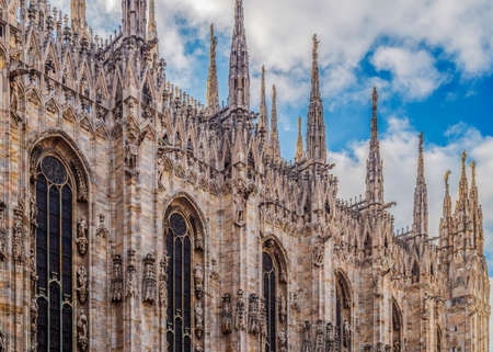 Detail of facade of the famous Milan Cathedral, Lombardy, Italy. Фото со стока