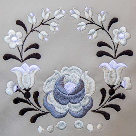 Background with detail of traditional Hungarian folk embroidery handmade on leather suport.