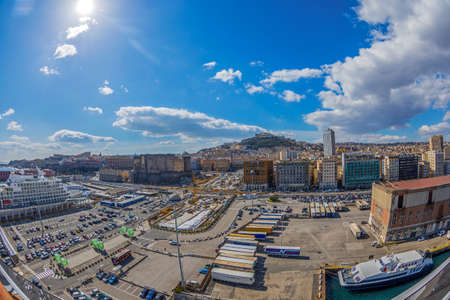 NAPLES, ITALY - MARCH 23, 2021: Port of Naples with Nuovo Castle and Sant Elmo Castle in the background.
