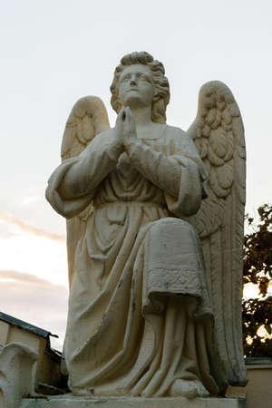 praying angel: Praying angel statue located in Saint Nectarios Monastary in Bucharest, Romania, Europe
