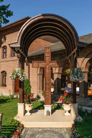 Jesus Christ carved on big wooden cross at Plumbuita monastery in Bucharest, Romania.