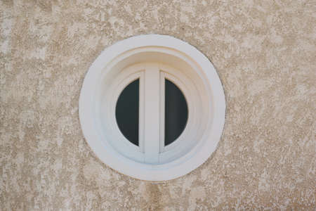 White round window close up. Deadpan photography.