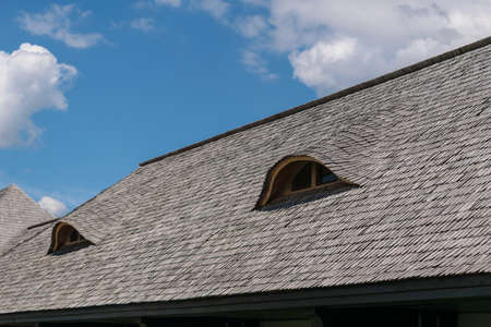 old traditional wood planks tiles roof with eye like windows