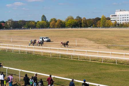 Ploiesti, Romania - October 07, 2018: People watching a  trotting horse race held on Ploiesti Hippodrome in Prahova, Romania.