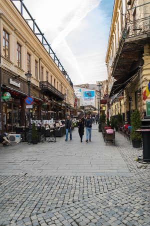 Bucharest, Romania - March 16, 2019: Tourists enjoying a walk on Lipscani street in Old Town part of Bucharest, Romania. Редакционное