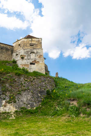 Detail of Rasnov Fortress protection tower build on top of solid bed rock 写真素材