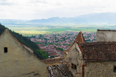 View of top of Rasnov city seen from Rasnov Fortress 写真素材