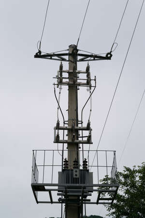 outdoor power transformer step down to mains 240v mounted on concrete mast Reklamní fotografie