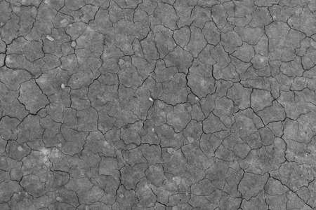 close-up detail of cracked soil mud pattern monocrome