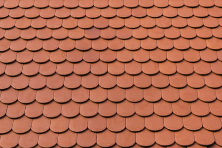 detail of new ceramic shingle roof tile background pattern
