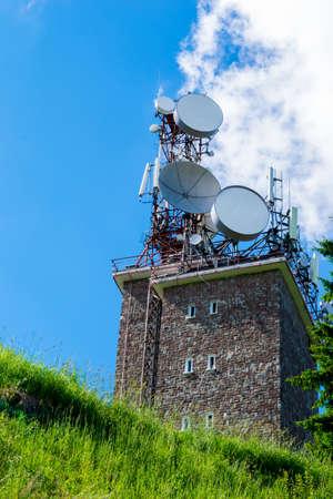 big wireless communication antennas mounted on top of utility building Reklamní fotografie