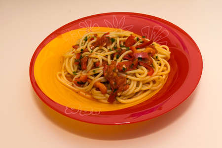 one plate with homemade pasta with fresh tomatoes sauce, pepper and basil