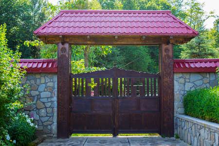 Wood gates an the entrance to Crasna Monastery in Prahova, Romania