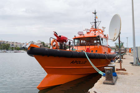 Constanta, Romania - August 14, 2019: Orange fireman boat docked at Constanta port, Romania. Redakční