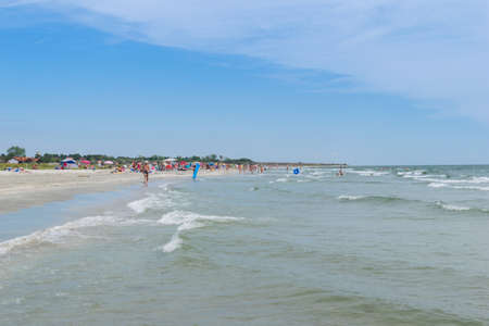 Corbu, Constanta, Romania - August 17, 2019: People enjoy a relaxing summer day on the last virging beach in Corbu, Romania.