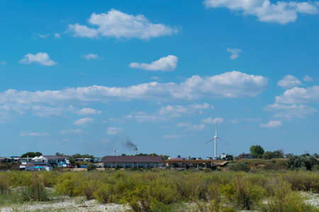 Corbu, Constanta, Romania - August 18, 2019: Buildings powered with green electricity generated by windmils at Corbu Beach, Romania.
