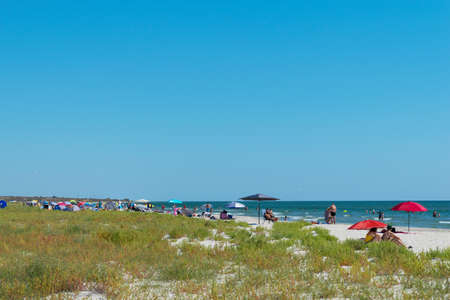 Corbu, Constanta, Romania - August 18, 2019: People enjoy a relaxing summer day on the last virging beach in Corbu, Romania.
