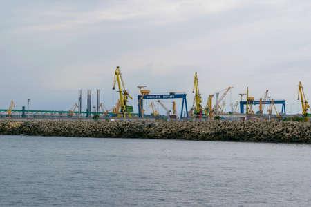Constanta, Romania - August 14, 2019: View of Constanta Shipyard cranes and port, Romania.