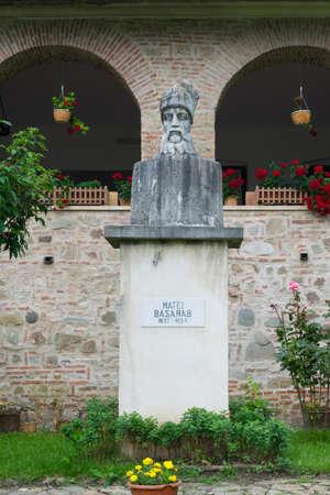 Brebu, Prahova, Romania - August 04, 2019: Matei Basarab bust statue situated in the Royal Court of Brebu Monastery complex
