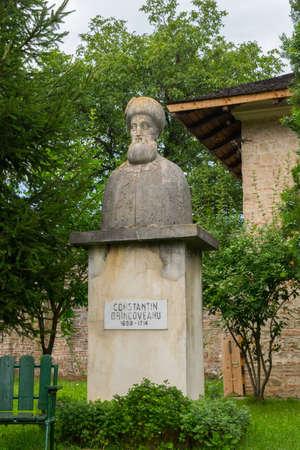 Brebu, Prahova, Romania - August 04, 2019: Constantin Brincoveanu bust statue situated in the Royal Court of Brebu Monastery complex Redakční