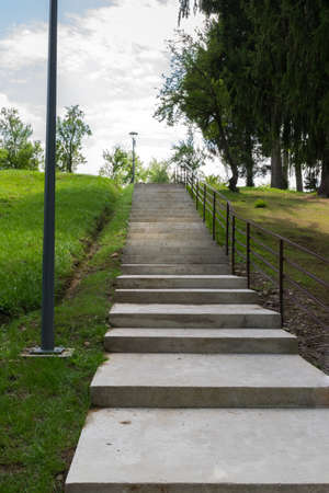 concrete stairs going upwards in a green park
