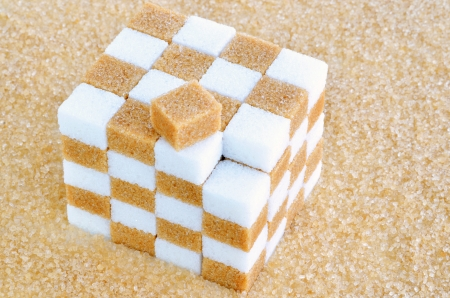 sugar cube: Cube of brown and white sugar cubes
