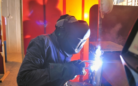 workplace safety: welder at factory Stock Photo
