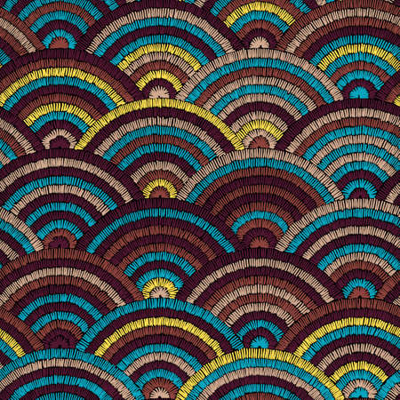 Seamless embroidered pattern. Wavy bohemian print. Patchwork ornament. Yellow, brown and blue colors. Vector illustration.