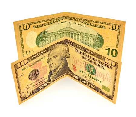 alexander hamilton: Ten dollars bills isolated on white background