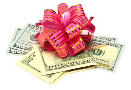 Dollars, surprise ribbon and bow isolated on white background