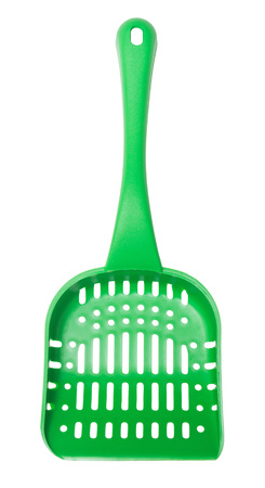 shovel in dirt: Green shovels animals isolated on a white background