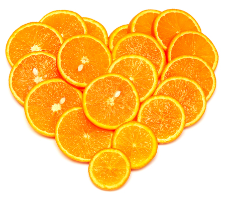 cantle: Heart from slices of orange fruit isolated on white background. Flat lay, top view. Love. Valentines Day