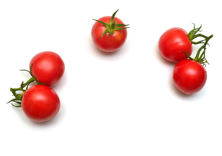 Tomatoes collection of whole and sliced isolated on white background. Tasty and healthy food. Flat lay, top view  Stock Photo