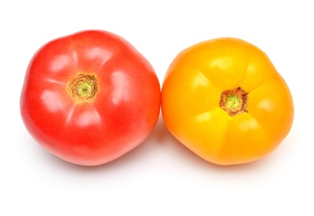 Varieties of tomatoes isolated on white background. Assorted tomato is yellow and pink. Grade. Flat lay, top view