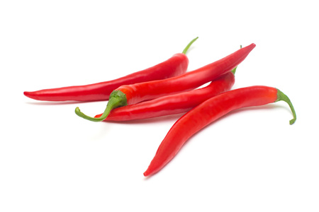 Red chili peppers isolated on white background. Creative spicy sharp. Flat lay, top view Archivio Fotografico