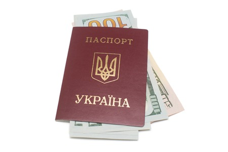 Ukrainian passport and dollars isolated on white background Фото со стока