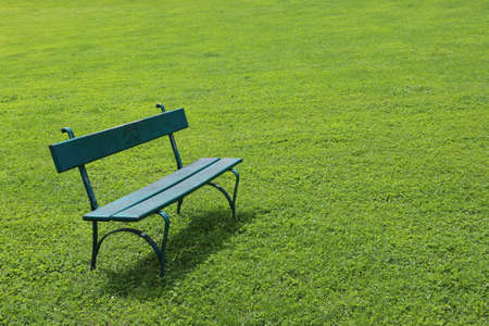 short cut: Lonely bench on short cut grass Stock Photo