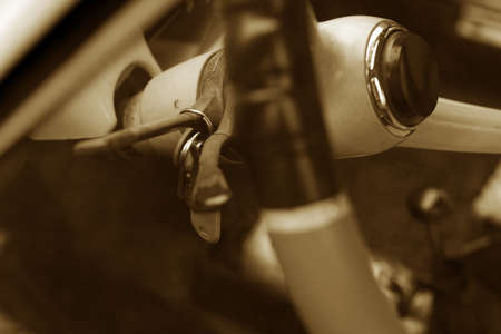 hanged: Hanged keys in old timer car with blurry steering wheel Stock Photo