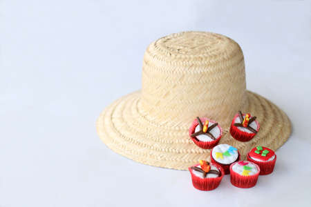 st john: Traditional brasilian hay hat and cupcakes decorated for celebrating St John