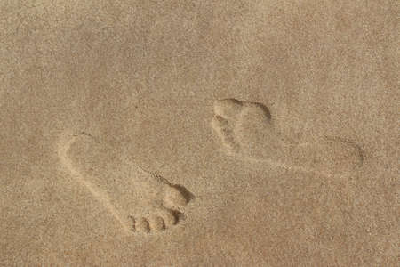 flat foot: Two different footprints on the sand, with normal and flat foot arch