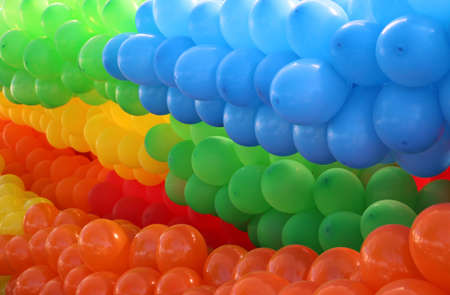 positioned: Many colorful balloons grouped by colors and diagonally positioned